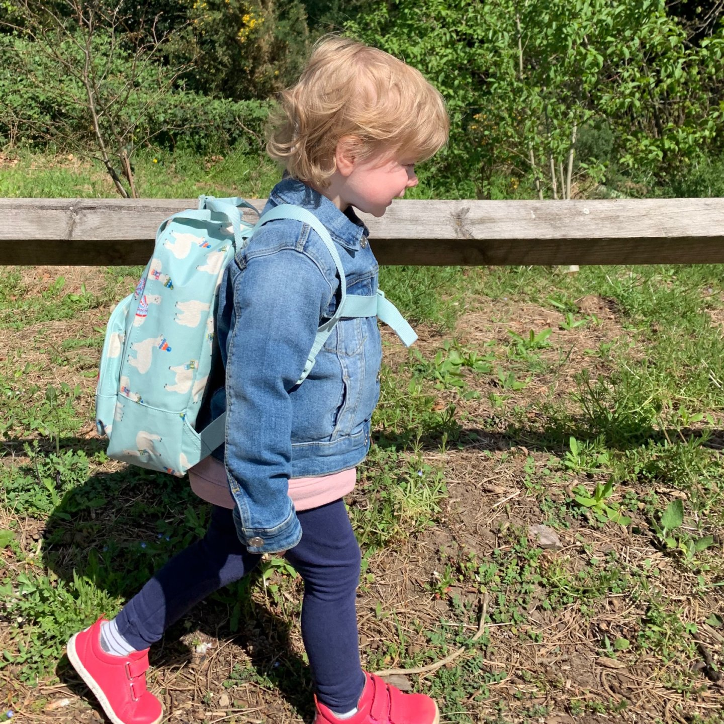 M walking home from her first day at preschool.