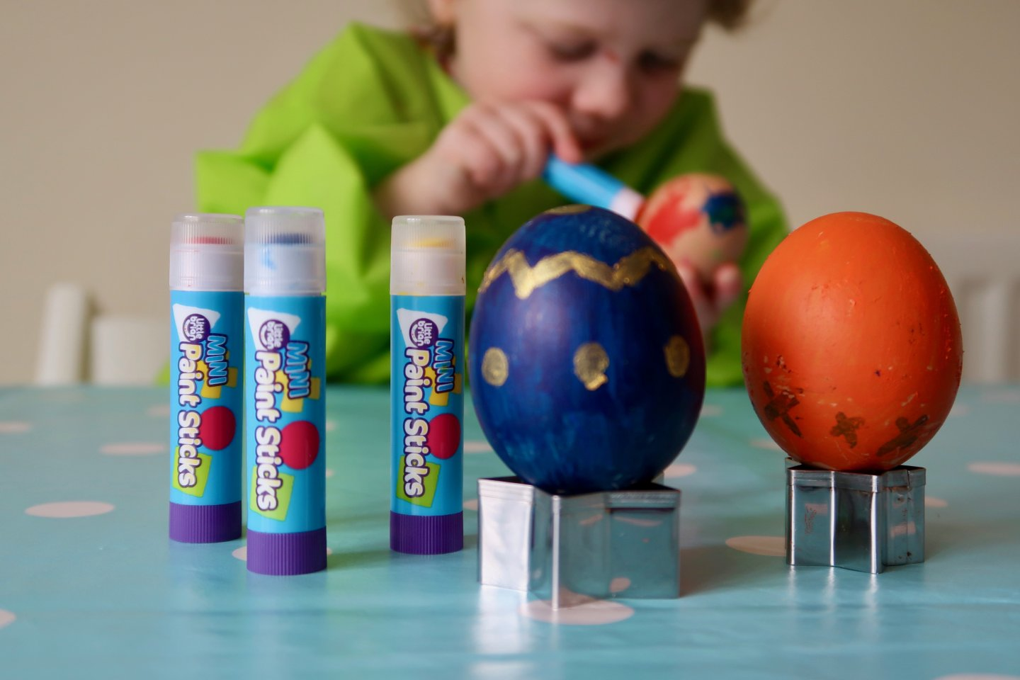 Painting boiled eggs for Easter.