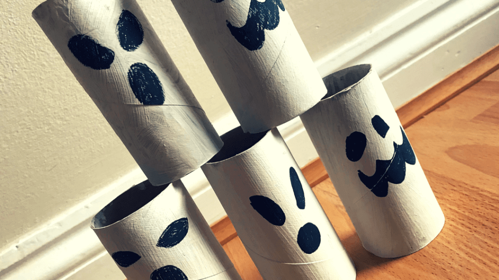 Halloween game made out of toilet rolls painted white and black to look like ghosts.