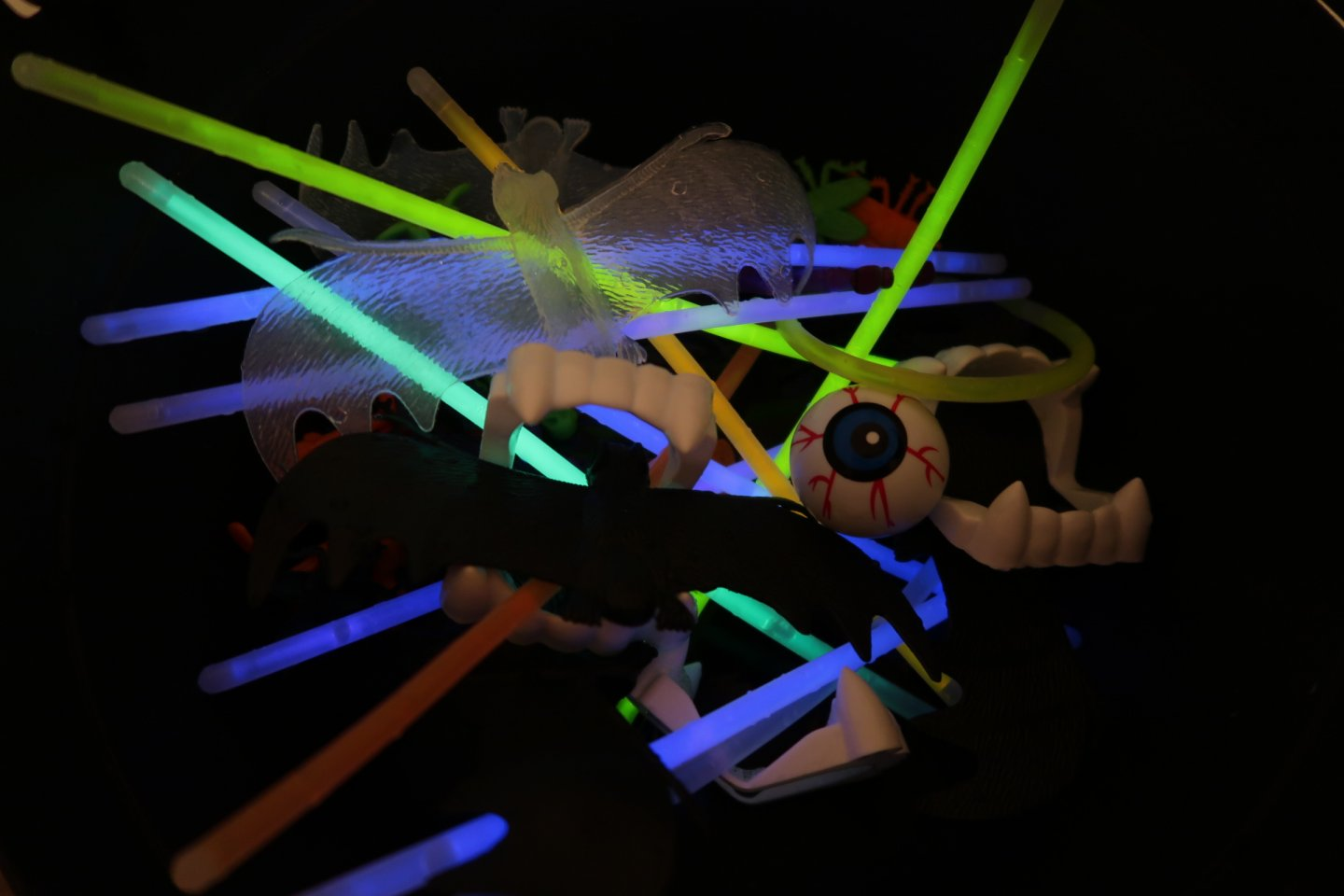 A collection of halloween props and glow sticks.