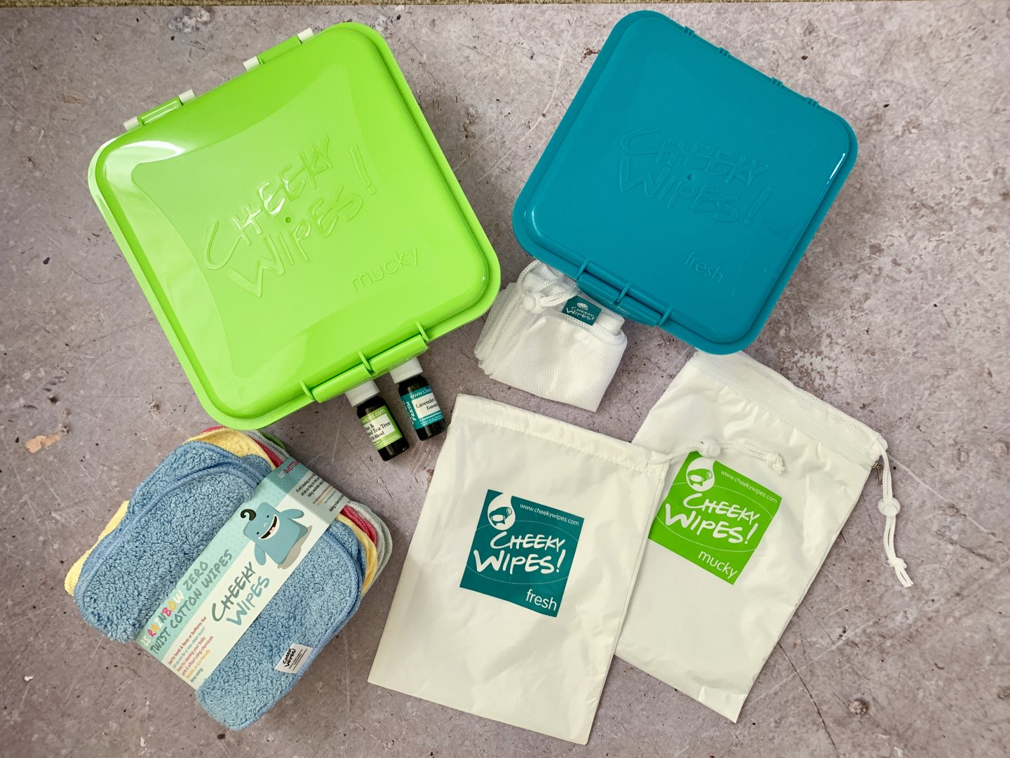 A photograph of everything included in the Cheeky Wipes kit.