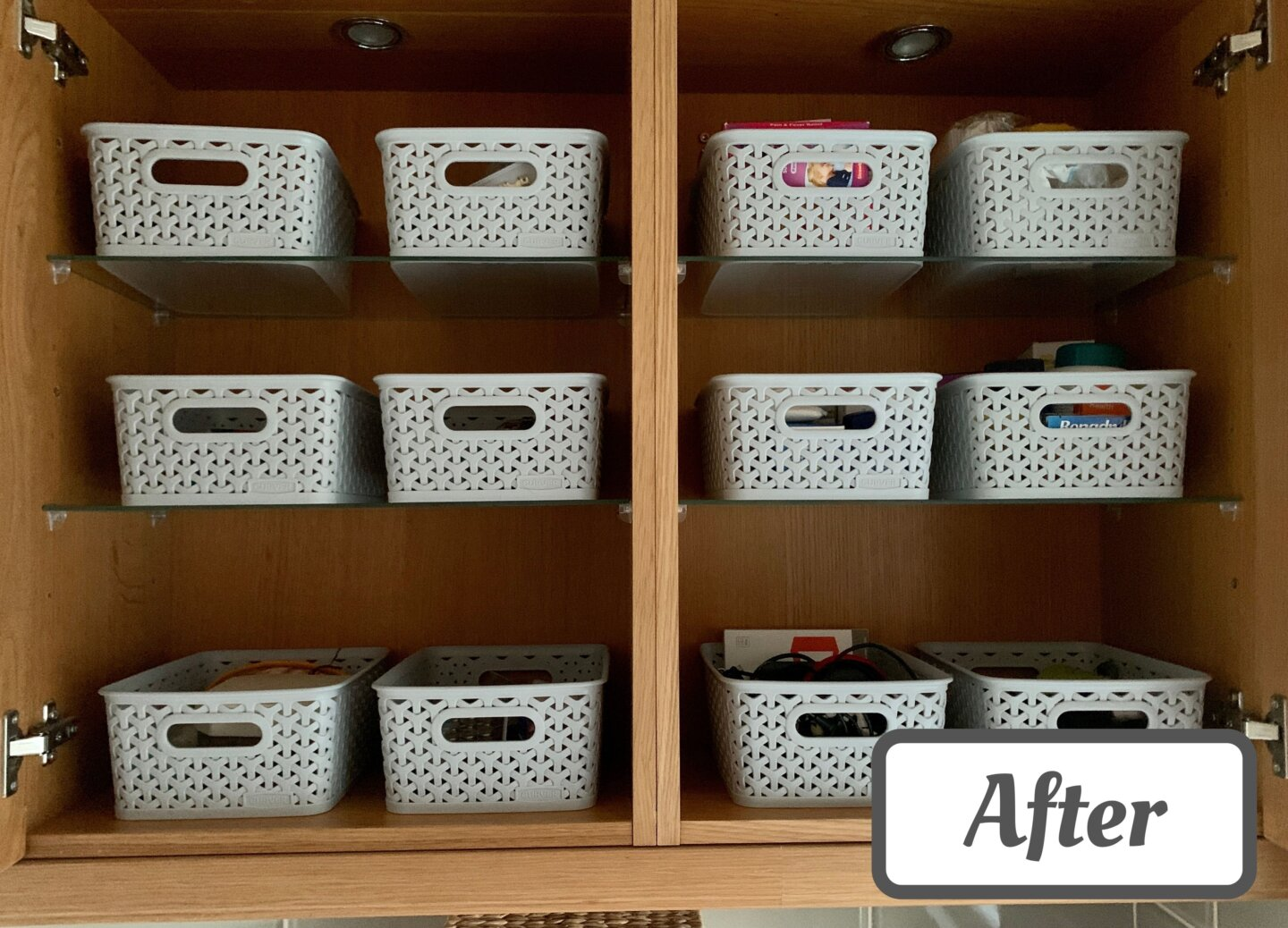 An image of a beautifully organised utility room cupboard with an 'after' sticker on it. 12 grey Curver baskets are arranged neatly across six shelves, with the contents placed neatly inside.