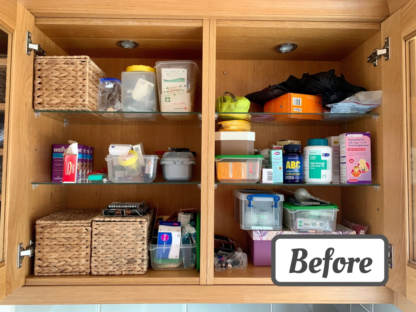 An image of a cluttered utility room cupboard with a 'before' sticker on it. Items such as vitamins, batteries and umbrellas are placed randomly on top of each other.